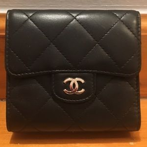 Black Chanel wallet with burgundy interior